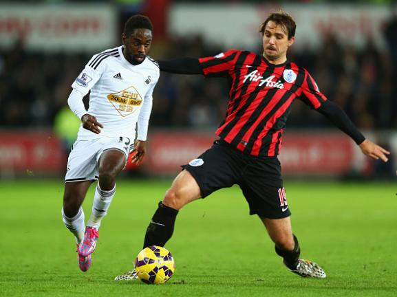 Nathan Dyer of Swansea City evades Niko Kranjcar of QPR during the Barclays Premier League match between Swansea City and Queens Park Rangers at Liberty Stadium on December 2, 2014 in Swansea, Wales. Getty Images)