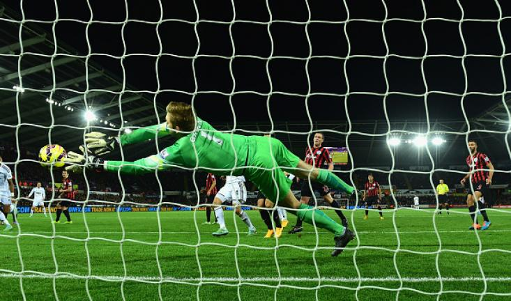 QPR goalkeeper Robert Green makes a finger tip save from Gylfi Sigurdsson (not pictured) during the Barclays Premier League match between Swansea City and Queens Park Rangers at Liberty Stadium on December 2, 2014 in Swansea, Wales. Getty Images