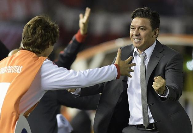 River Plate coach Marcelo Gallardo (R) and his son celebrate the goal scored by defender Gabriel Mercado against Colombia's Atletico Nacional during their Copa Sudamericana 2014 second leg final football match at the Monumental stadium in Buenos Aires.Getty Images