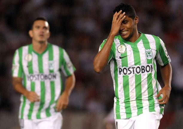 Atletico Nacional forward Luis Ruiz (R) reacts after missing a chance to score against Argentina's River Plate during their Copa Sudamericana 2014 second leg final football match at the Monumental stadium on December 10, 2014. Getty Images
