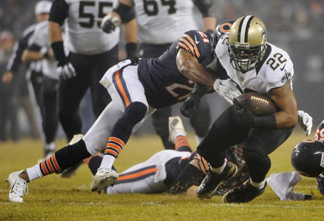 Mark Ingram #22 of the New Orleans Saints is tackled by Ryan Mundy #21 of the Chicago Bears during the first quarter at Soldier Field on December 15, 2014 in Chicago, Illinois. (Getty Images)