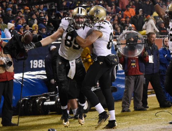 Josh Hill #89 of the celebrates his touchdown with Nick Toon #88 of the New Orleans Saints (right) during the second quarter of their game against the Chicago Bears at Soldier Field on December 15, 2014 in Chicago, Illinois. (Getty Images)