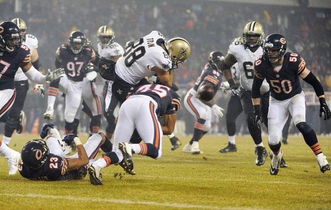 Nick Toon #88 of the New Orleans Saints fumbles as he is hit by Brock Vereen #45 of the Chicago Bears during the first quarter at Soldier Field on December 15, 2014 in Chicago, Illinois. (Getty Images)