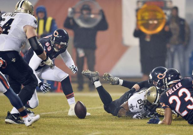 Jared Allen #69 of the Chicago Bears recovers a fumble by Nick Toon #88 of the New Orleans Saints (not pictured) during the first quarter at Soldier Field on December 15, 2014 in Chicago, Illinois. (Getty Images)