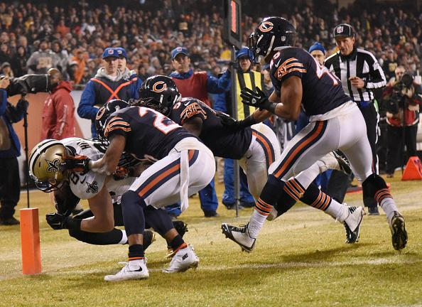 Josh Hill #89 of the New Orleans Saints heads into the end zone for a touchdown as Tim Jennings #26, Christian Jones #59 and Brock Vereen #45 of the Chicago Bears defend during the second quarter at Soldier Field on December 15, 2014 in Chicago. (Getty Images)