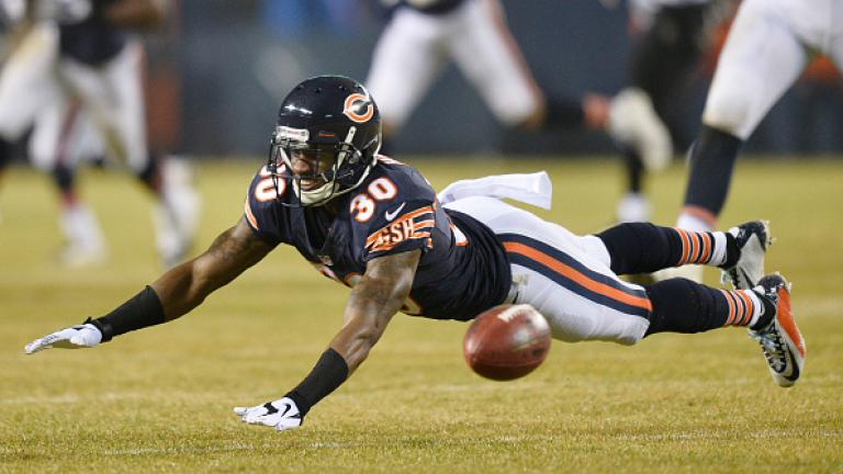 Demontre Hurst #30 of the Chicago Bears dives for an incomplete pass on a fake field goal during the first quarter of a game against the New Orleans Saints at Soldier Field on December 15, 2014 in Chicago, Illinois. (etty Images)