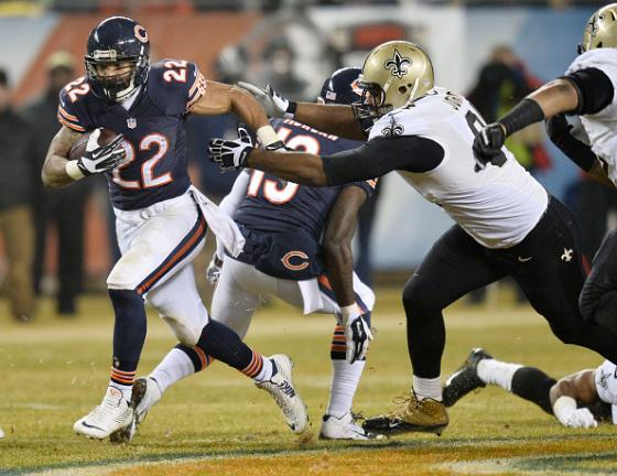 Matt Forte #22 of the Chicago Bears runs the ball during the first quarter of a game against the New Orleans Saints at Soldier Field on December 15, 2014 in Chicago, Illinois. (Getty Images)