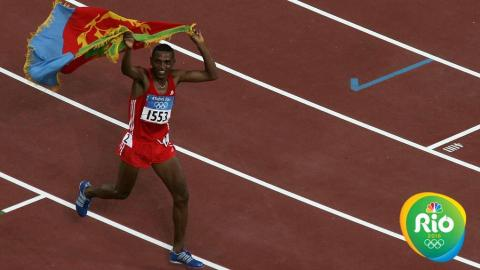 Zersenay Tadesse of Eritrea celebrates after he came third in the men's 10,000 metre event on August 20, 2004 during the Athens 2004 Summer Olympic Games at the Olympic Stadium in the Sports Complex in Athens, Greece. (Photo by Nick Laham/Getty Images)