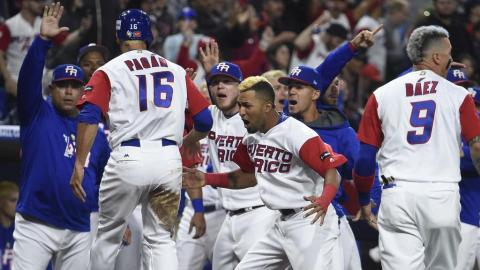 Angel Pagan of Puerto Rico is congratulated after scoring during the first inning of the World Baseball Classic Pool F Game Four between the United States and Puerto Rico at PETCO Park on March 17, 2017 in San Diego, California. (Getty Images)