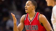 C.J. McCollum #3 of the Portland Trail Blazers talks to his teammates during the first half against the Cleveland Cavaliers at Quicken Loans Arena on December 8, 2015 in Cleveland, Ohio. (Photo by Jason Miller/Getty Images)