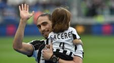 TURIN, ITALY - MAY 14: Martin Caceres of Juventus FC with his children celebrates after beating UC Sampdoria 5-0 to win the Serie A Championships after the Serie A match between Juventus FC and UC Sampdoria at Juventus Arena on May 14, 2016 in Turin, Ital