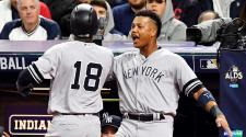 Didi Gregorius of the New York Yankees celebrates with Starlin Castro in the third inning against the Cleveland Indians in game five of the American League Divisional Series at Progressive Field on October 11, 2017 in Cleveland, Ohio. (Getty Images)