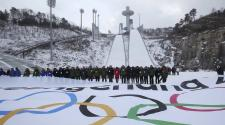 Participants attend an event marking the three-year countdown to the start of the 2018 Winter Olympics at Alpensia Ski Jumping Center in Pyeongchang, South Korea. (AP Photo)