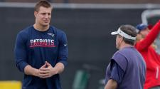 Rob Gronkowski #87 of the New England Patriots, left, and head coach Bill Belichick during a practice session. (Photo by Bob Levey/Getty Images)