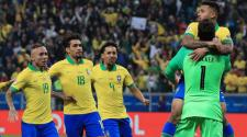 Alisson Becker of Brazil celebrates with Gabriel Jesus winning in the penalty shootout after the Copa America Brazil 2019 quarterfinal match between Brazil and Paraguay at Arena do Gremio on June 27, 2019 in Porto Alegre, Brazil. (Getty Images)