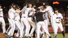 Chris Herrmann #10 and Brandon Drury #27 of the Arizona Diamondbacks celebrate with teammates after defeating the Colorado Rockies 11-8 in the National League Wild Card game at Chase Field on October 4, 2017 in Phoenix, Arizona. (Getty Images)